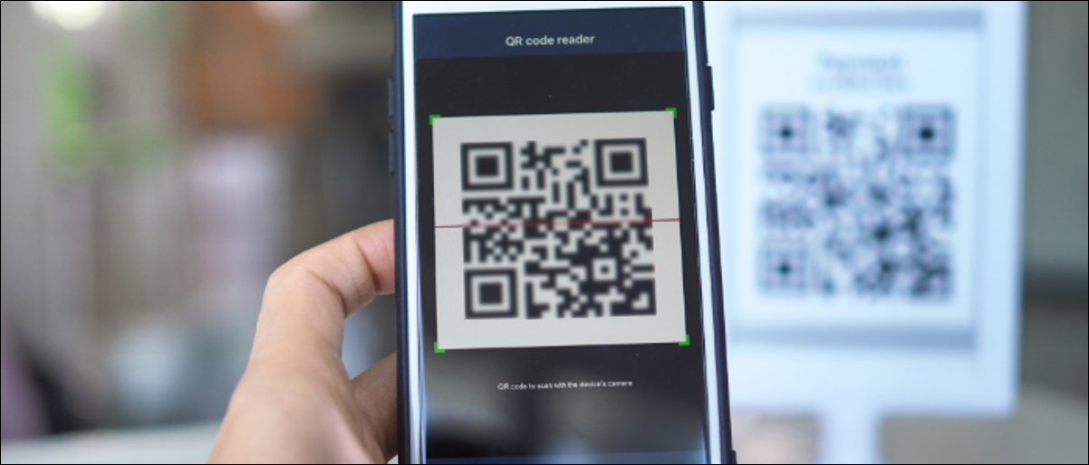 Using a phone to access QR codes.