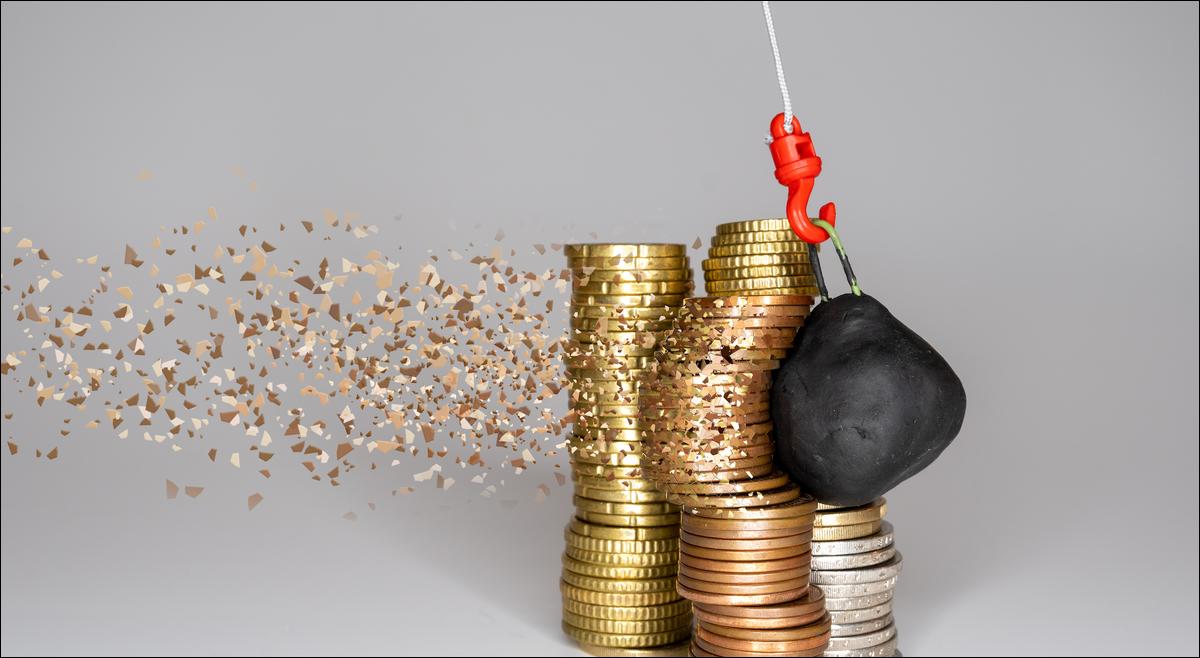 ball smashing stack of coins