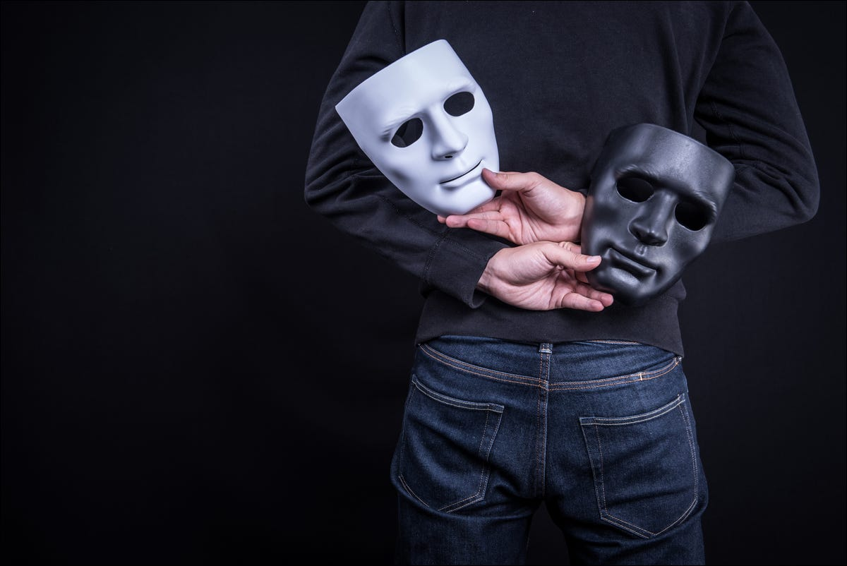 mystery man holding masks