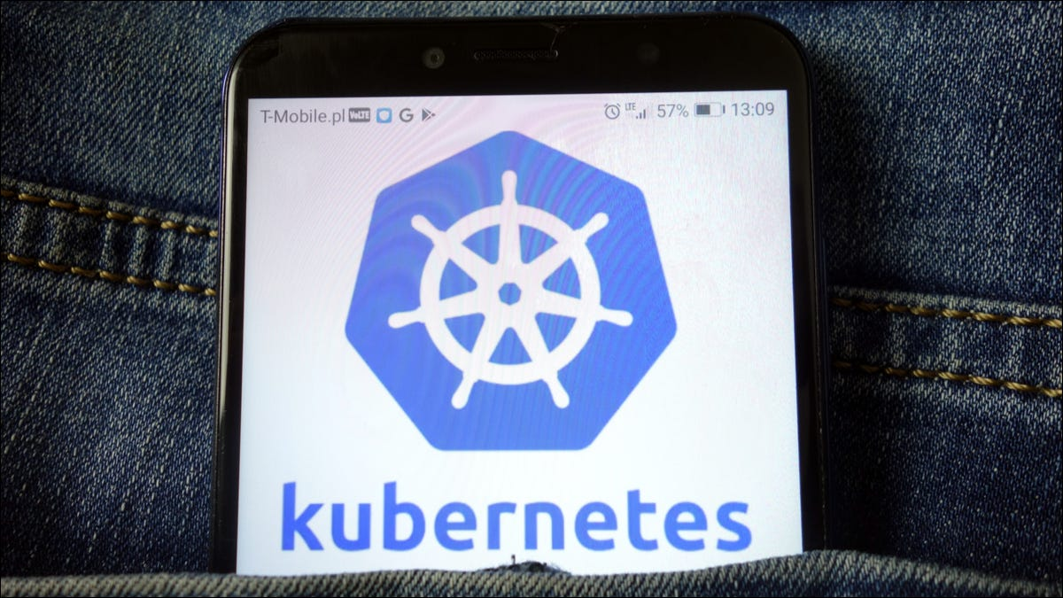 Photo of the Kubernetes logo showing on a smartphone